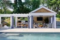 Pool Cabana with Black and White Striped Grommet Curtains