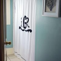 Beach Style Bathroom with Blue Sea Fan Art - Cottage ...