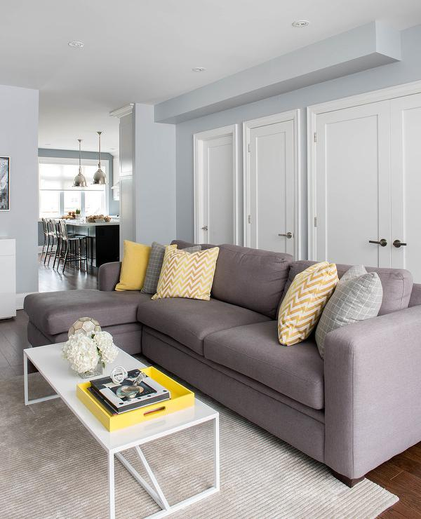 Gray Sofa with Chaise Lounge and Yellow Pillows