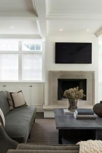 Modern Gray Stone Fireplace with Flat Panel Television
