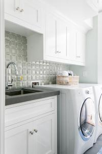 White and Gray Galley Style Laundry Room - Cottage ...