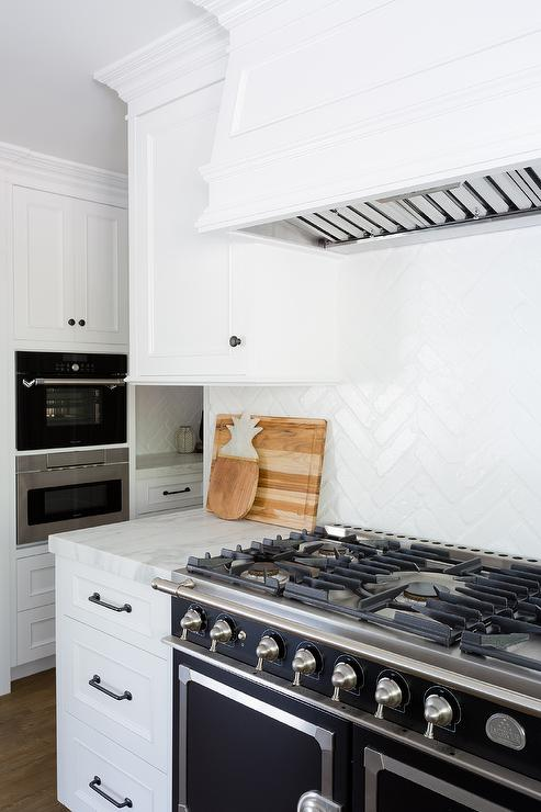 Black And White Marble Wallpaper White Vent Hood With Black Range Transitional Kitchen