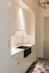 White Galley Laundry Room with Dove Gray Door ...