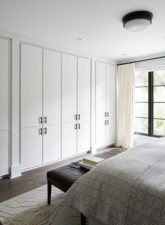 Full Size Bed With Storage Wall Of Floor To Ceiling Closet Cabinets - Modern - Bedroom
