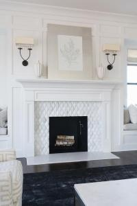 Black Sconces on White Board and Batten Fireplace Wall ...