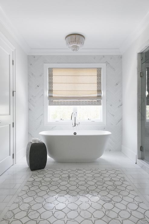 Egg Shaped Tub With Black And White Oval Tile Floor