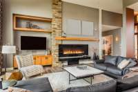 casual-living-room-with-large-leather-sofa-fireplace ...