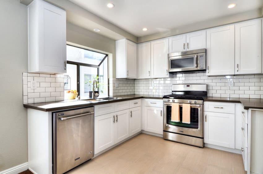 small kitchen dark laminate counter white tile backsplash glass splashes glass splashes ideas