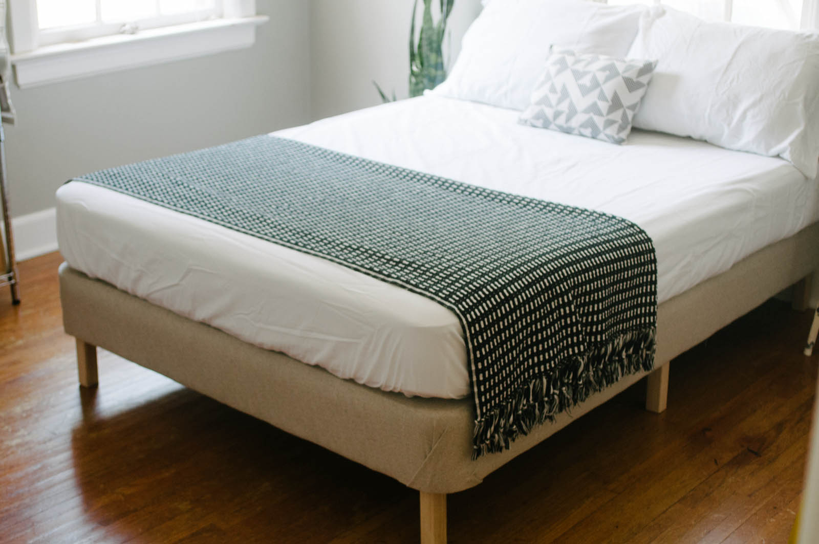 At the clever bunny you can find out all of the details behind this modern diy bed taking a box spring and making a bed frame is easier than you may think