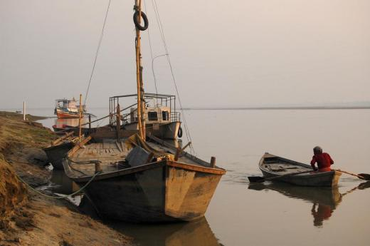 River sand mining is a threat to fields and plantation along the river as the latter gets widened Credit: ptwo/ Flicker