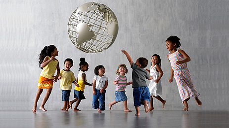 Children dancing around our earth