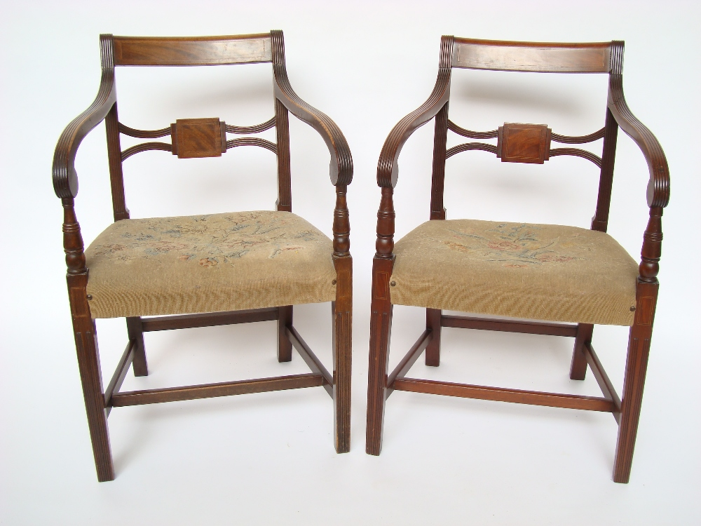 A Near Pair Of Late Regency Style Mahogany Elbow Chairs
