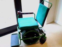 Stepper-motorised wheelchair