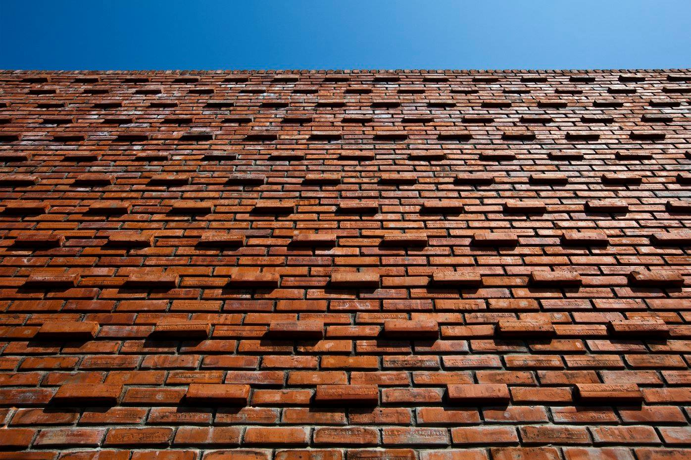 Brick Wall Design A Creative Brick House Controls The Interior Climate And