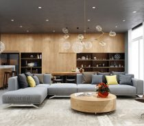 Grey floors, curtains, and sofa set the decor theme against a backdrop of rich wood grain. A leather chair and marble countertop contribute to a luxurious aesthetic, while starburst pendant lights invoke magical modern inspiration. This open layout is certainly inspiring – especially for those who have an eye for detail.