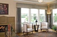Traditional Living Room in Merriam - tray ceiling, beige ...