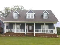 Cape Cod Home Exterior in Prattville - windowed door ...
