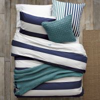 Layered bedding for a cozy spring bedroom