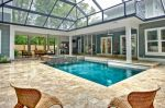Enclosed Pool With Outdoor Kitchen