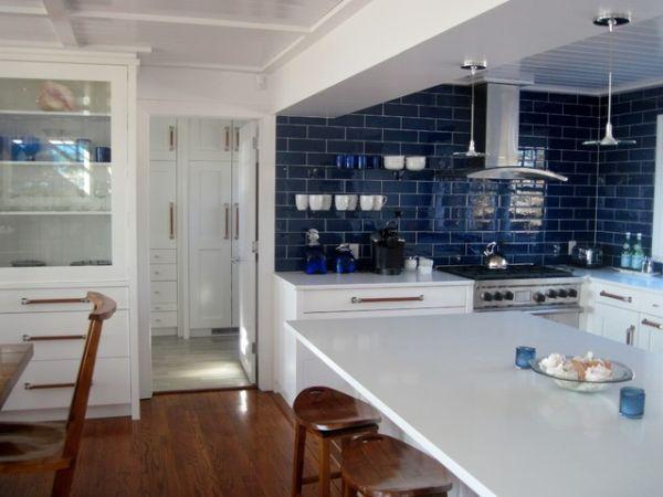 pops ocean blue room ideas inspiration kitchen rich brown cabinetry mosaic tile backsplash hgtv