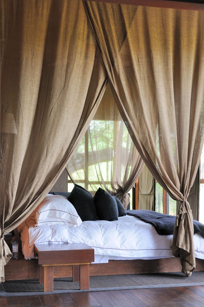 bedroom curtains behind bed