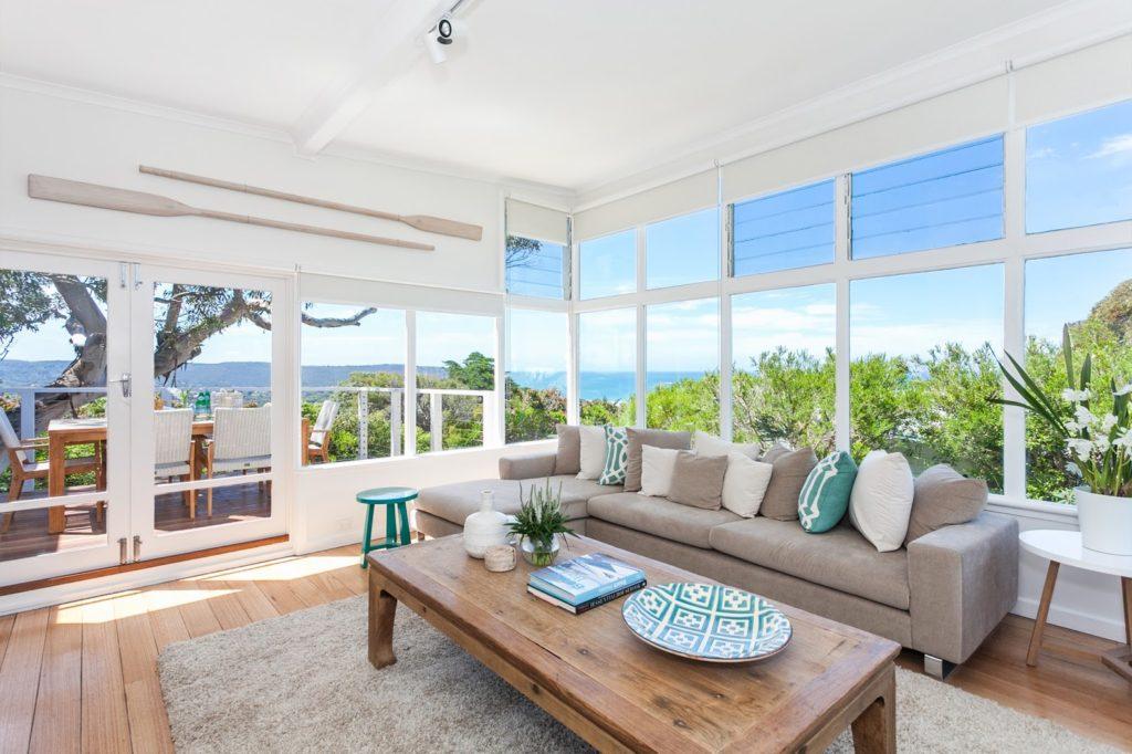 Serene Beach House Taken Over By Coastal Beauty - beach living room furniture