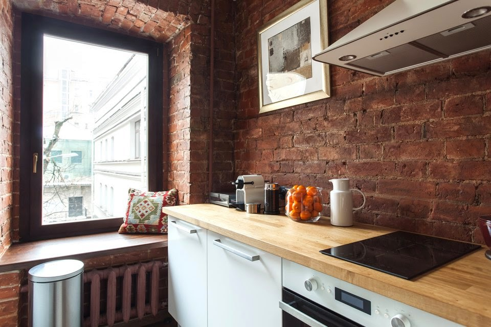 Table Island Kitchen Studio Apartment Stays Authentic By Keeping Its Brick