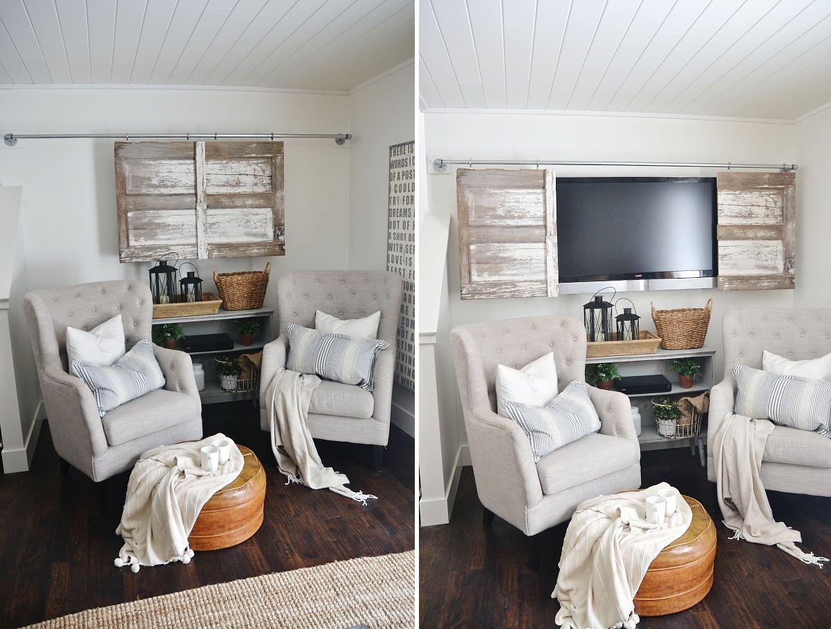 Diy industrial barn door with pipes to hide a tv