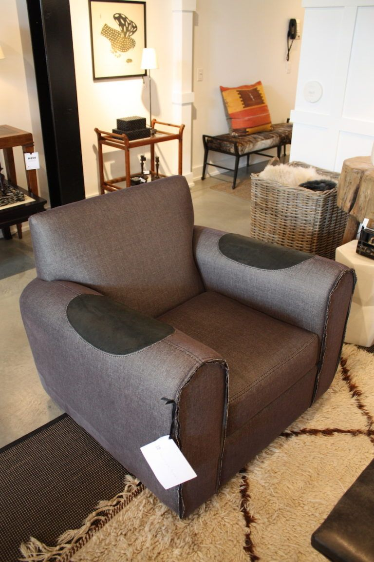 This fabulous chair practically begs you to plop down! The raw-edge detailing and leather arm patches remind you of your that favorite sweater that's so comfortable you just can;t part with it.