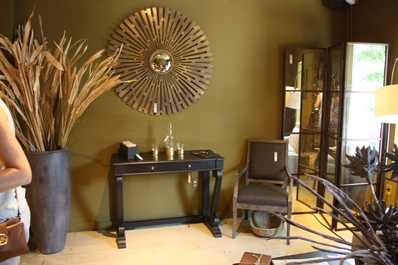 Magnificent accessories can easily elevate a space, whether it's a commanding piece of wall decor or a large vase, with your favorite botanical stems bursting forth. A mirrored screen also adds cachet and helps enlarge a compact room.