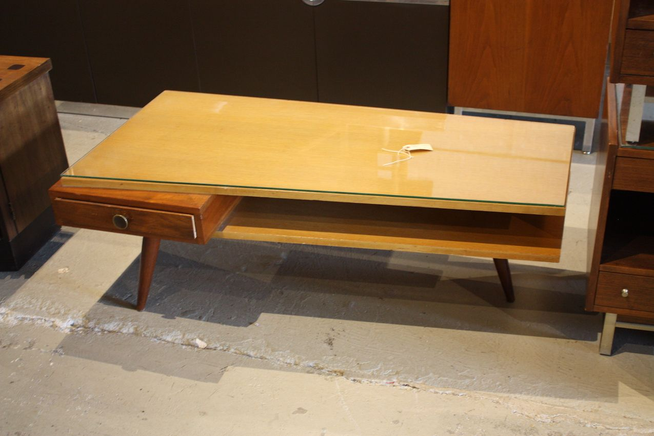 What a fantastic find! This mid century coffee table is amazing, from its unique shape, mix of woods, slim drawer and elegant legs.