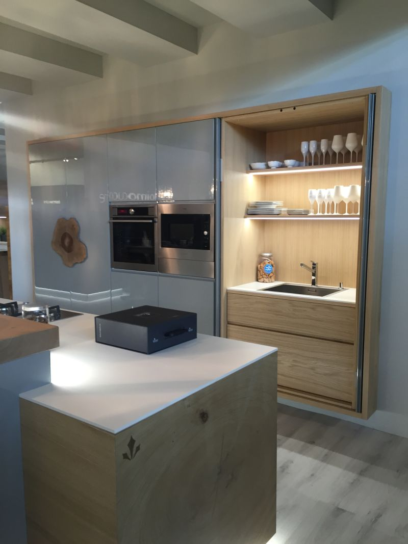 Pocket doors to hide the kitchen sink and storage shelves
