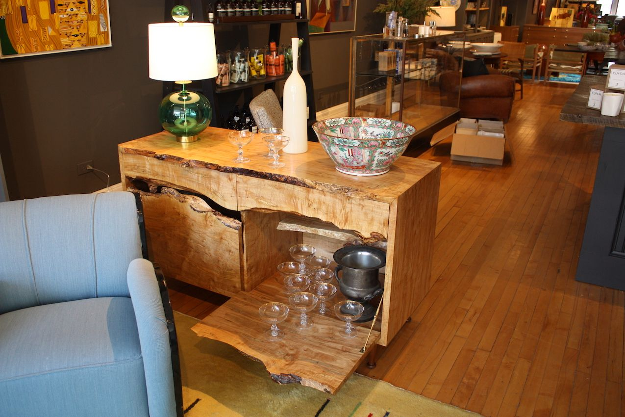 Traveling the design shows, we've seen plenty of beautiful live edge pieces, but this stunning bar piece is truly one-of-a-kind.