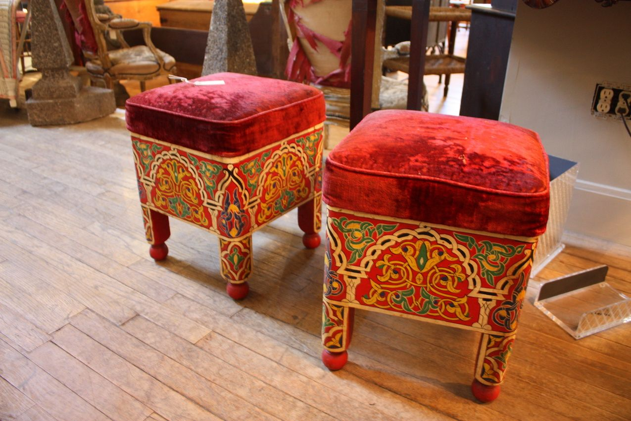 What a pair! A spectacular pop of color for any room, these upholstered Moroccan stools are just beautiful. The detail of the design is lovely and the legs are particularly nice, capped off with red ball feet.