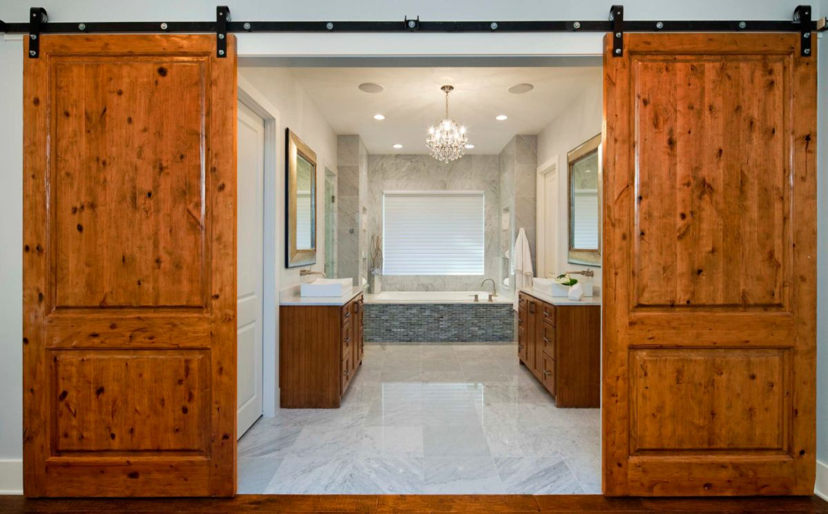 Barn Doors For Homes How To Make The Most Of A Barn Door In A Bedroom Bathroom Scenario