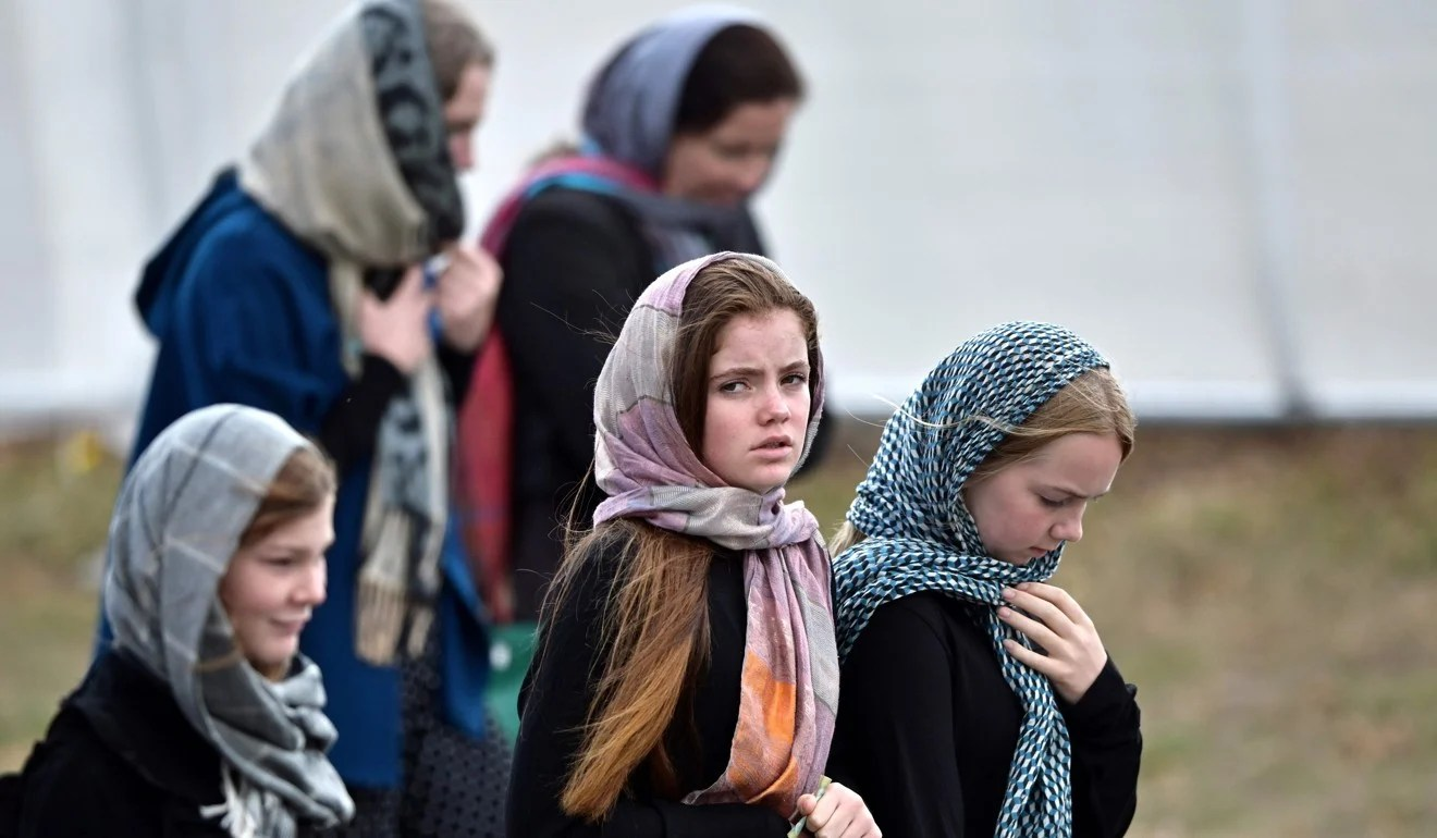 Schoolchildren attend the funeral of those killed in New Zealand's twin mosque attacks at Memorial Park cemetery in Christchurch. Photo: AFP
