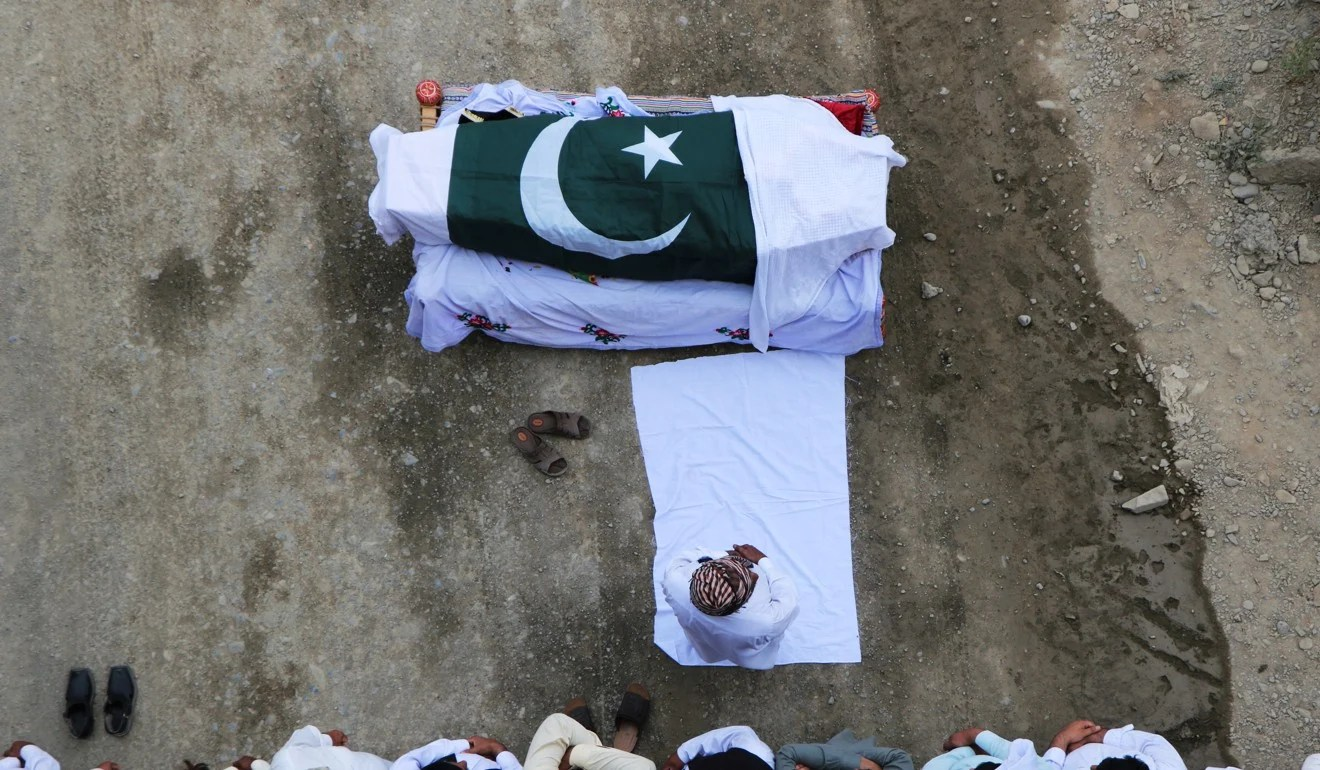 The funeral of Awais Ali Shah, a security supervisor killed after separatist insurgents attacked a luxury hotel in the port city of Gwadar. Photo: Reuters