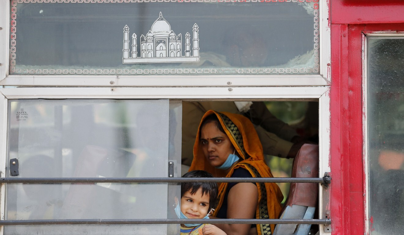 A migrant labourer, who arrived from Gujarat state on a train, inside a bus leaving for her native village in Uttar Pradesh, India. Photo: AP
