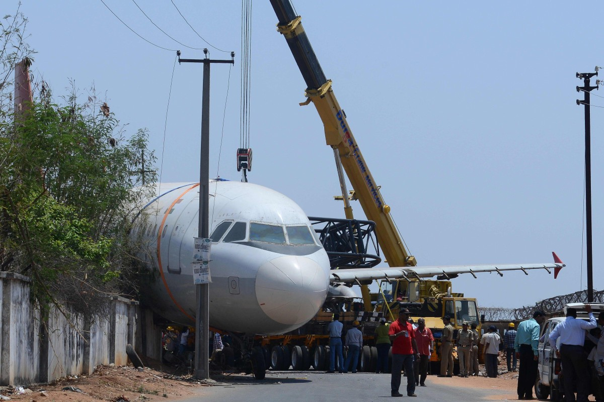 A disused Air India passenger plane which fell from a ground transporter while being moved near Begumpet Airport in Hyderabad. India's aviation sector is going through a rough patch. Photo: AFP