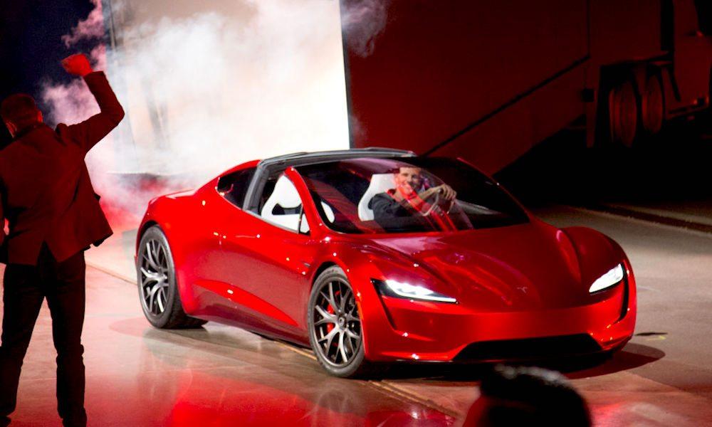 Elon Musk Car In Spac Wallpaper Tesla Unveils New Blazing Fast All Wheel Drive Roadster
