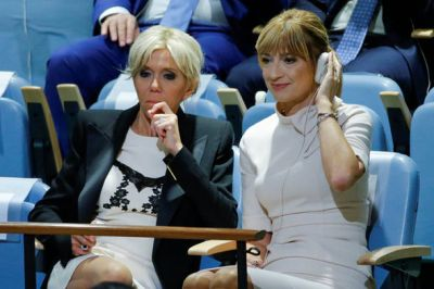 Brigitte Macron news: French first lady gives cheeky flash ...
