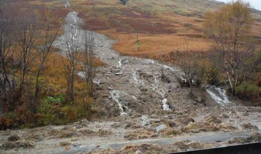 Landslides have closed several roads across Scotland as further heavy rains batter the country