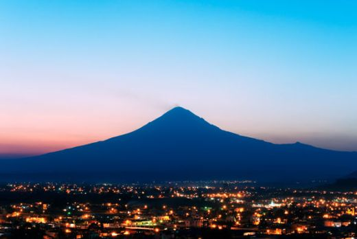 This image of Popocatépetl at night shows how many people live around the fire mountain