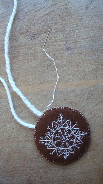 embroidered_felt_snowflake_pendant.jpg