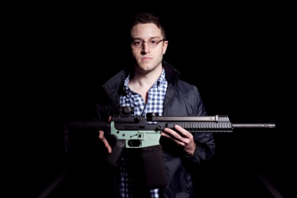 Cody R. Wilson with AR-15.  The gun has a 3D-printed lower receiver. (Photo: Marisa Vasquez / The Daily Texan)