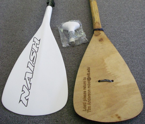 "Here's a Naish carbon stand-up paddle that retails for $3.99, next to my ""copy"" which didn't cost anything to make and took an hour or so of work."