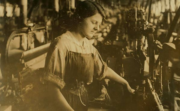 Mill girl working at a loom