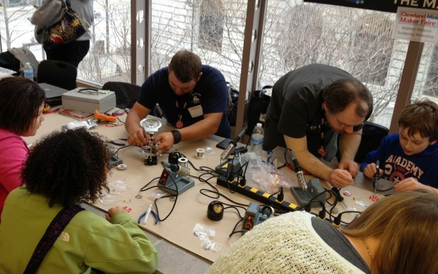 Here are other attendees learning to solder.