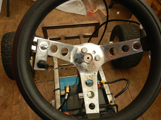 """Nitro"" button on the steering wheel. Throttle and brake handles are in back."