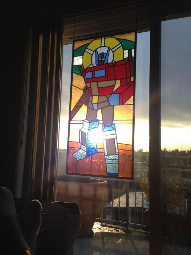 St. Optimus of Prime stained glass window only transforms the light passing through it.